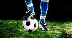 soccer cleats, socks and ball